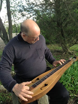 Jim Phillips makeswooden dulcimers by hand and from scratch.