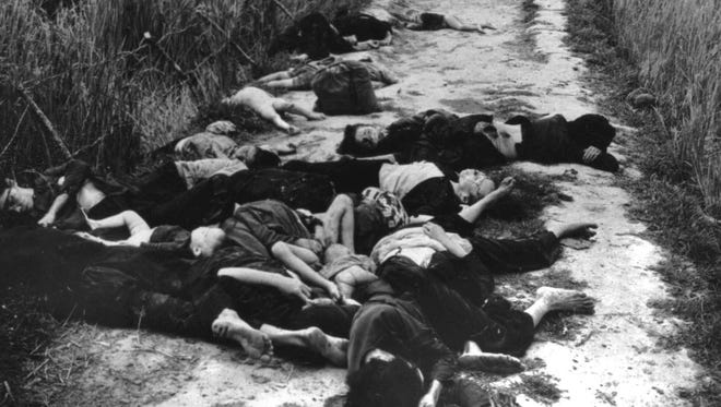 Bodies of women and children lie in the road leading from the village of My Lai, South Vietnam, following the massacre of civilians in March 1968.