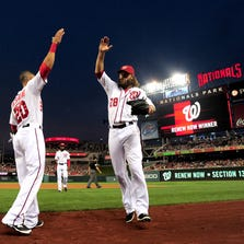 Aug 1, 2014; Washington, DC, USA; Washington Nationals outfielder Jayson Werth (28) is congratulated by shortstop Ian Desmond (20) after throwing a runner out at home in the fifth inning against the Philadelphia Phillies at Nationals Park. The Phillies won 2-1. Mandatory Credit: Evan Habeeb-USA TODAY Sports