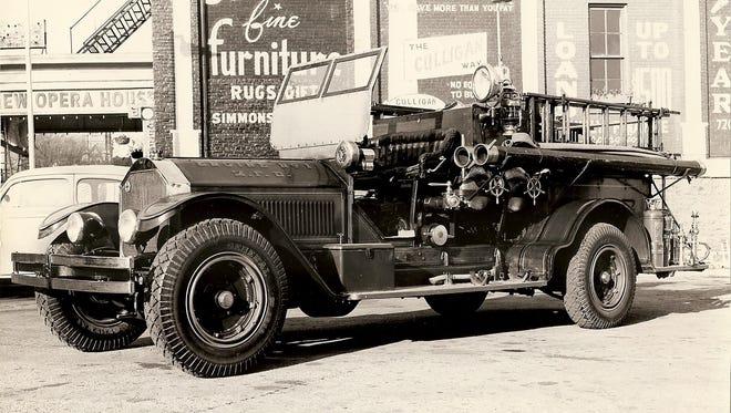 Engine No. 1, 600-gallon pumper, put into service 1910. Photo taken in 700 block of Chicago Street in Manitowoc, circa 1947.