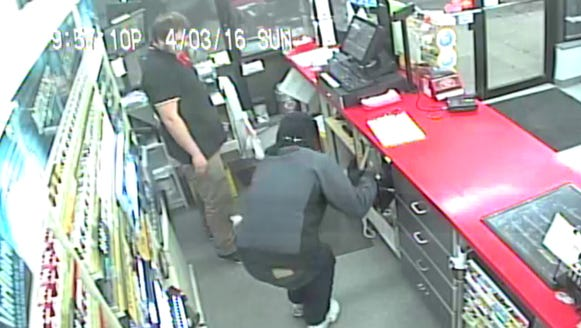 Surveillance photo of Git-N-Go robbery suspect.