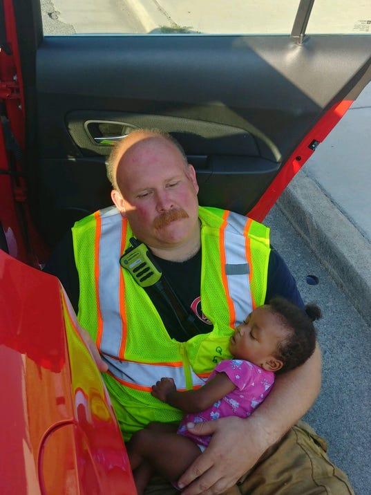 636638896774753229-firefighter-holding-baby.jpg