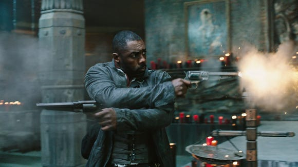 "Have guns, will travel for Roland Deschain (Idris Elba) in ""The Dark Tower."""
