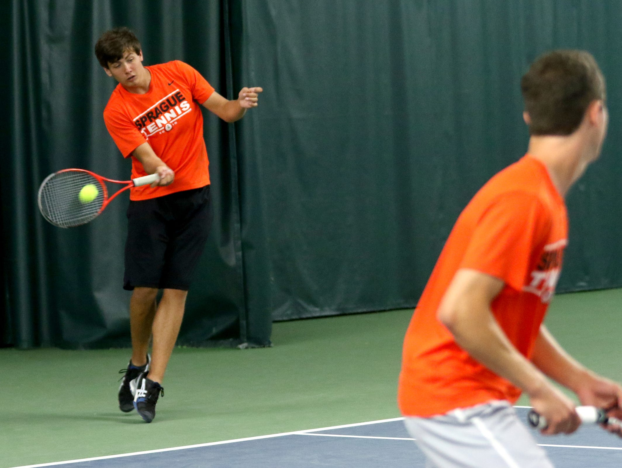 Sprague's Nate Harder, left, and Jonah Lovell compete in the boy's doubles championships at the Greater Valley Conference district meet at the Salem Tennis and Swim Club on Saturday, May 14, 2016. They placed second.