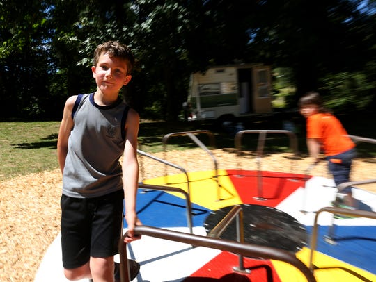 Evan Breen, 9, of Mill City, rides a merry-go-round