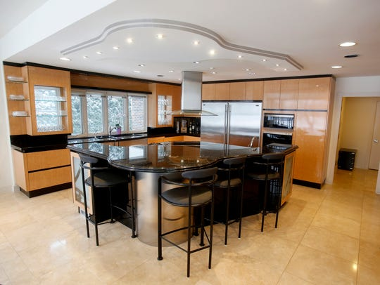 The large kitchen area with spacious island with sitting