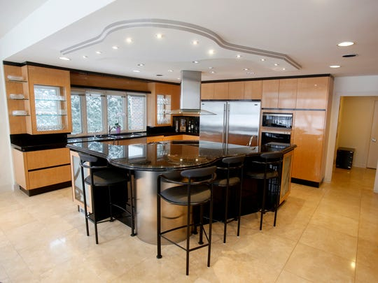 The large kitchen area with spacious island with sitting area and stove in this 6,537 square foot home as seen on Friday, January 12, 2018 in the Wabeek subdivision in Bloomfield Township, Michigan.
