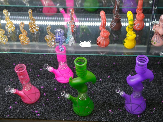 Items are shown in a display case at Pipe Dreams on