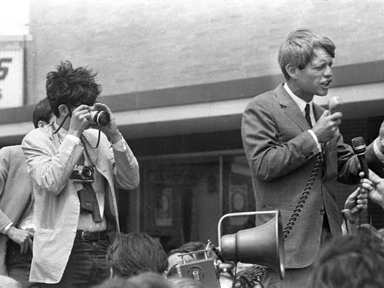 Michigan Daily photographer Andrew Sacks focuses his camera on Sen. Robert Kennedy during his May 15, 1968 visit to Detroit.