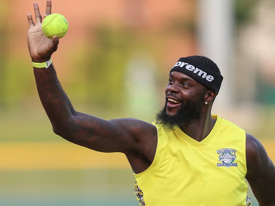 Indiana Pacer Lance Stephenson holds up the ball after