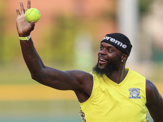 Indiana Pacer Lance Stephenson holds up the ball after outing a Colts team opponent during the 10th Annual Caroline Symmes Memorial Celebrity Softball Challenge at Victory Field in Indianapolis, Thursday, June 7, 2018. The game raises funds for the Indiana ChildrenÕs Wish Fund, granting wishes to Indiana children who have life-threatening illnesses.