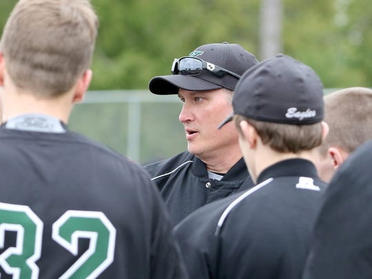 Klahowya baseball coach Dan Erickson talks with his team after the game against Coupeville.