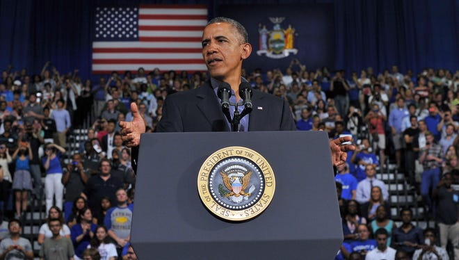 US President Barack Obama speaks on education at University of Buffalo, the State University of New York, on August 22, 2013 in Buffalo, New York. Obama is on a two-day bus tour through New York and Pennsylvania to discuss his plan to make college more affordable, tackle rising costs and improve value for students and their families.