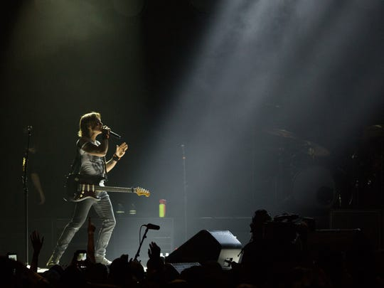 Keith Urban walks the stage while performing at the Pan American Center at New Mexico State University, Tuesday, October 18, 2016.