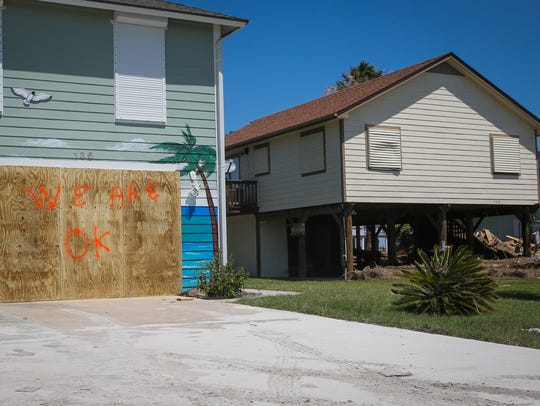 A home remains boarded up Wednesday, Aug. 30, 2017,