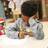 Javion Tanksley works on a drawing of what the future will look like at  Kodak Park School 41,