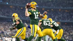 Packers QB Aaron Rodgers (12) carved up the Cowboys