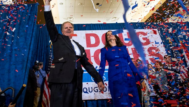 Sen.-elect Doug Jones and his wife Louise greet supporters as he claims victory at his watch party.