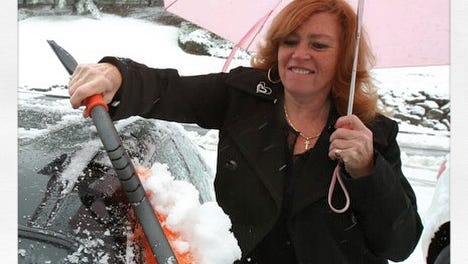 Amid last winter's near-constant snowfall, Helen Panaro of Pomona cleared snow off her car one afternoon in West Nyack. Because, that's what a good driver does.