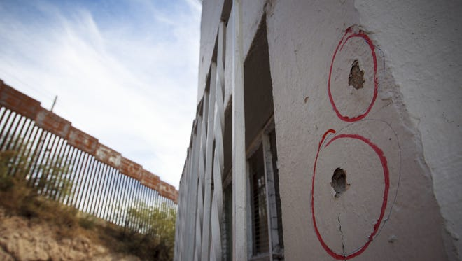 A Texas case going before the U.S. Supreme Court on Feb. 21, 2017, could determine whether the family of a teenager killed in Nogales, Mexico, will be able to sue the Border Patrol agent who fired the fatal shot through the border fence.  Here, two of many bullet holes are circled on the emergency medical office building in Nogales, Sonora, where Jose Antonio Elena Rodriguez, 16, died after being shot by a. Border Patrol agent on the other side of the fence.