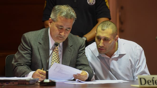 Murder suspect Allan Agababa, right, with defense attorney Douglas B. Moylan at the Superior Court of Guam on Oct. 6, 2017. Moylan appeared on behalf of attorney Curtis Van de veld who was in Saipan at the time.