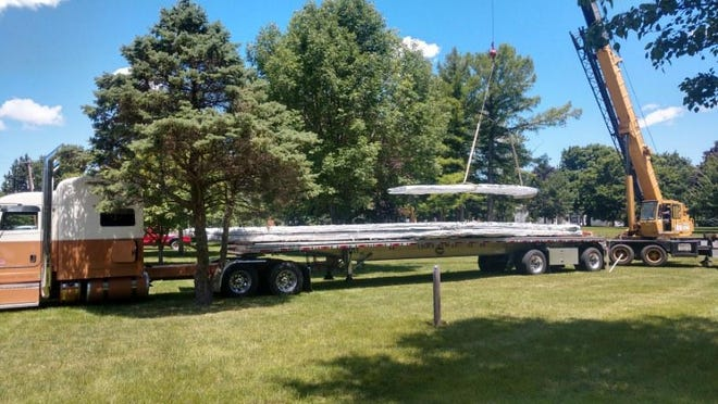 A crane unloads portions of the stage to be erected in Wiley Park