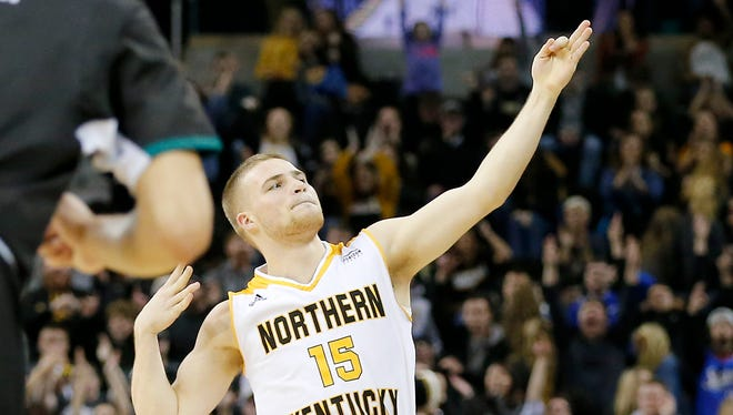 Northern Kentucky Norse guard Tyler Sharpe (15) fires and arrow into the crowd after sinking a three point shot in the second half of the NCAA Horizon League basketball game between the Northern Kentucky Norse and the Green Bay Phoenix at BB&T Arena in Highland Heights, Ky., on Saturday, Feb. 10, 2018. The Norse took an 86-80 win over Green Bay.