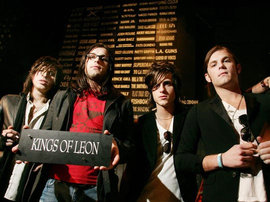 Matthew, Nathan, Jared and Caleb Followill of the band Kings of Leon have their name added to the Exit/In's Wall of Fame on Dec. 15, 2005.