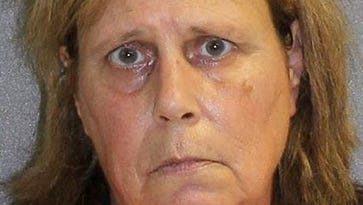 Cops: Woman murdered husband by blocking his nose