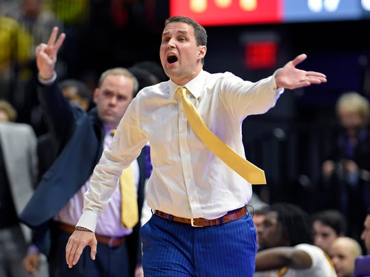 LSU coach Will Wade shouts instructions to his players during the first half of an NCAA college basketball game against Florida on Wednesday, Feb. 20, 2019, in Baton Rouge, La. (AP Photo/Bill Feig)