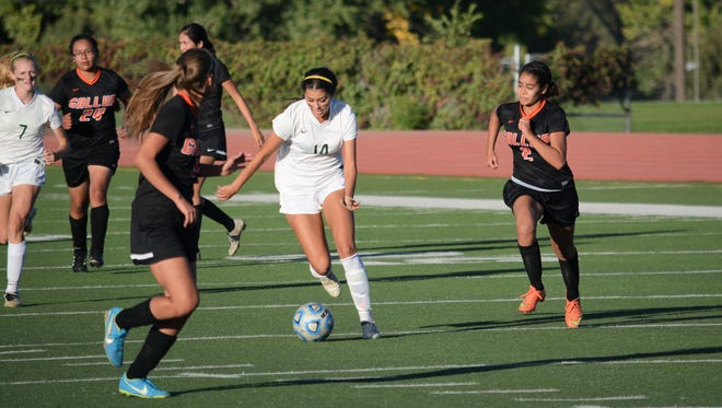 Farmington's McKenzie Coleman goes on the attack dribbling down the field in the District 1-5A opener against Gallup Tuesday at Hutchison Stadium. The Lady Scorpions look to make an even deeper playoff run in 2017.