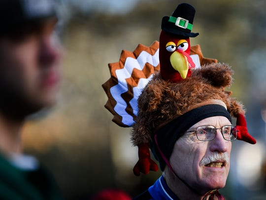 David Dickinson wears a turkey on his head as he warms up before the 24th Annual Boulevard Bolt 5 Mile Run-Walk to raise money for the homeless in Nashville, Tenn., Thursday, Nov. 23, 2017.