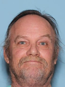 Destry Lynn McClure, 52, arrested on suspicion of dragging his dog behind his truck for half mile.