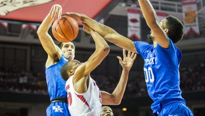 Jan 21, 2016; Fayetteville, AR, USA; Arkansas Razorbacks forward Keaton Miles (55) has his shot blocked by Kentucky Wildcats forward Derek Willis (35) and Wildcats forward Marcus Lee (00) during the first half of play at Bud Walton Arena. Mandatory Credit: Gunnar Rathbun-USA TODAY Sports