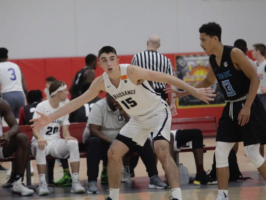 Class of 2020 point guard Ethan Morton (15) calls for