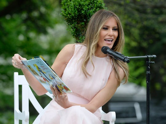 First lady Melania Trump reads a book to children at