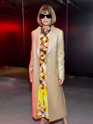 """Vogue editor-in-chief Anna Wintour is staying on """"indefinitely,"""" Conde Nast said Tuesday."""