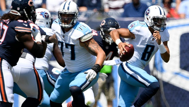 Titans quarterback Marcus Mariota (8) scrambles in the first quarter of a preseason game against the Bears at Nissan Stadium Sunday, Aug. 27, 2017 in Nashville, Tenn.