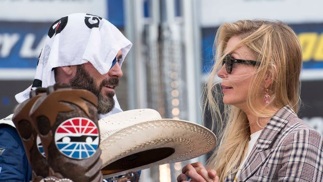 Jimmie Johnson tries to cool down in victory lane at Texas Motor Speedway.