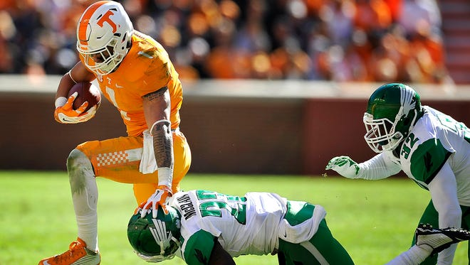 Tennessee running back Jalen Hurd (1) evades a tackle by North Texas defensive back Kishawn McClain (23) on Nov. 14, 2015.