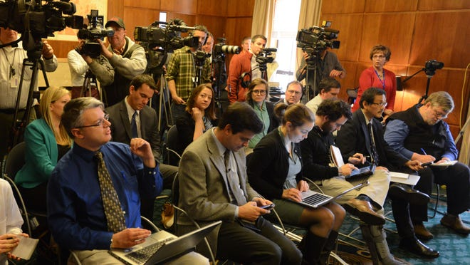 Members of the media pack the governor's ceremonial office at the Capitol on Friday, Feb. 20, to listen to Gov. Kate Brown. .