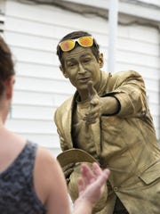 Anthony Button entertains as Gold Man on the boardwalk