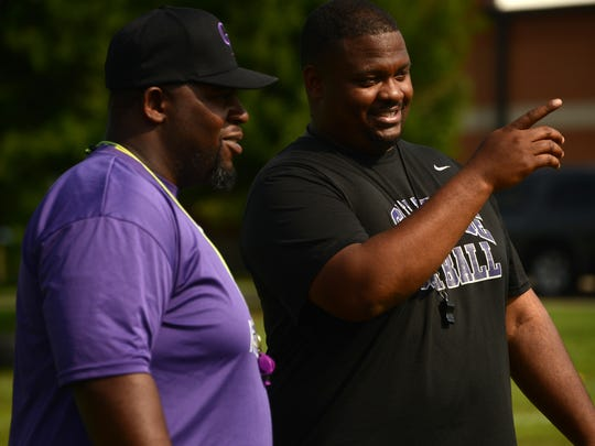Head coach Eddie Woods, right, and defensive backs
