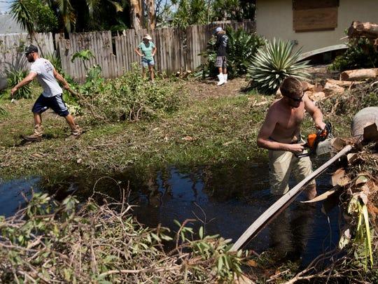 Residents clear Hurricane Irma landscape debris from
