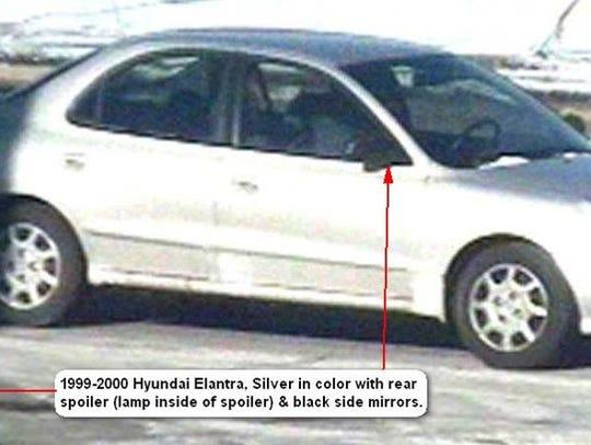 Suspect's car has black mirrors, eight-spoke wheels