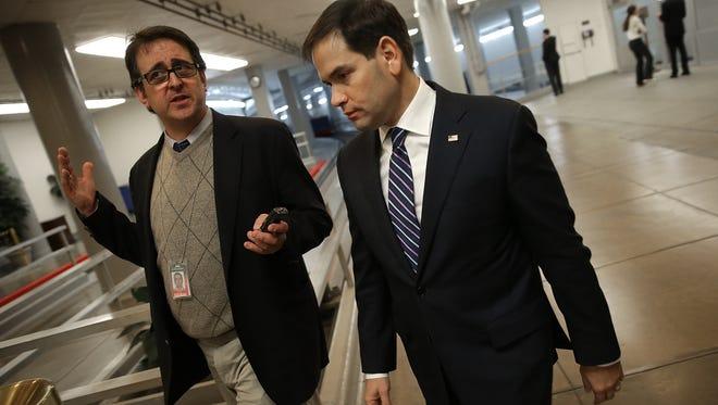 Sen. Marco Rubio, R-Fla., right.