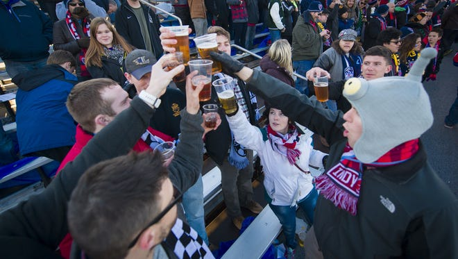 Members of the Brickyard Battalion do a toast as teams prepare to kickoff at the start of the game. The Indy Eleven opened their 2016 season against Ottawa Fury Saturday, April 9, 2016, at IUPUI's Michael A. Carroll Track and Soccer Stadium.