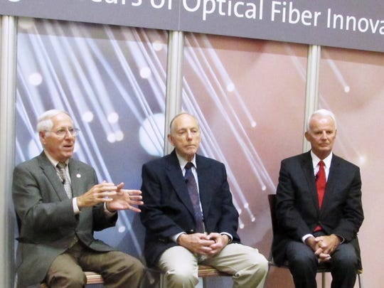 Retired Corning Glass Works (now Corning Inc.) scientists, from left, Donald Keck, Robert Maurer and Peter Schultz discuss the impact of their development of optical fiber technology during a 45th anniversary celebration Tuesday at Sullivan Park research facility.