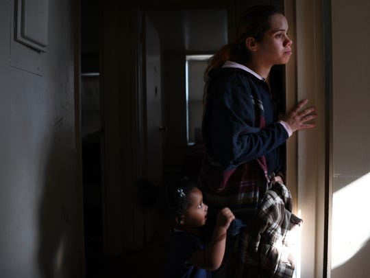 Yanira Cortes, 28 of Newark, with her daughter Brielle, 2, at their apartment at Pueblo City. Pueblo City has been ordered closed in the past by the city for substandard conditions