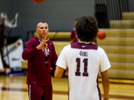 First Baptist head coach Scott Stewart calls out drills during the team practice on Monday.